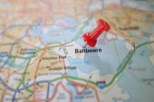 stock photo of maryland  - Red push pin in a map of Baltimore Maryland - JPG