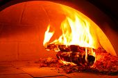 image of firewood  - Close up firewood oven with flame ready for bake pizza - JPG