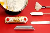 image of confectioners  - cannolo siciliano with mixture and confectioner utensils - JPG