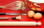 stock photo of confectioners  - confectioner itensils with cake mixture and eggs - JPG