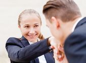 foto of politeness  - Young businessman greet polite his partner with kissing hand