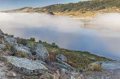 stock photo of collins  - fog over Horsetooth Reservoir in Rocky Mountain foothills near Fort Collins - JPG
