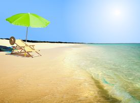 foto of summer beach  - Image of chair and umbrella at the beach - JPG