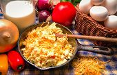 stock photo of scrambled eggs  - Cast Iron Skillet with western style scrambled eggs  Including onions - JPG