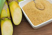 stock photo of sugar industry  - Close up Sugar and sugarcane on wooden table - JPG