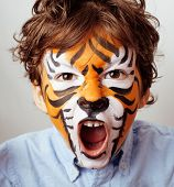 stock photo of tigers  - little cute boy with faceart on birthday party close up - JPG
