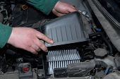 image of hand truck  - mechanic in the hand, remove car air filter ** Note: Soft Focus at 100%, best at smaller sizes - JPG
