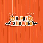 stock photo of orange  - happy halloween hanging decoration on orange background - JPG