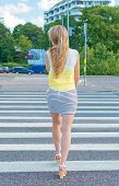 stock photo of pedestrian crossing  - Woman crossing the road at pedestrian crossing - JPG