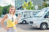foto of campervan  - Beautiful young woman offers campervans at shop - JPG