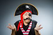 stock photo of buccaneer  - Funny pirate in the dark studio - JPG