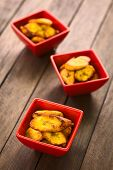 image of plantain  - Fried slices of the ripe plantain in small red bowls which can be eaten as snack or is used to accompany dishes in some South American countries  - JPG