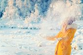 stock photo of swag  - Young Woman playing with snow Outdoor Winter Lifestyle happiness emotions nature on background - JPG