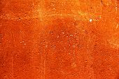 picture of scratch  - Grunge plaster cement or concrete wall texture orange color with scratches - JPG