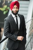 picture of turban  - Young indian businessman in turban is looking at camera - JPG