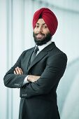 foto of turban  - Portrait of young indian businessman in suit and turban - JPG
