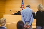 picture of court room  - Judge about to bang gavel on sounding block in the court room - JPG