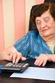 Elderly  Business Woman Calculating