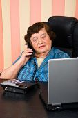 Busy Elderly Business Woman In Office