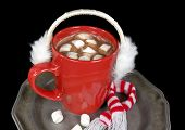 stock photo of ear candle  - White furry ear muffs on a hot chocolate drink in red mug with marshmallows and striped scarf.