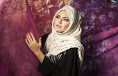 stock photo of burqa  - portrait of a young Arab girl in a white scarf and burqa - JPG