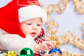 picture of christmas baby  - Beautiful little baby celebrates Christmas. New Year