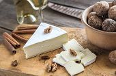 picture of brie cheese  - Brie Cheese With Walnuts On The Wooden Table - JPG