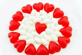 stock photo of jelly beans  - Valentine candies of June Hearts and white jelly beans on white background - JPG