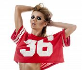 picture of cheerleader  - Beautiful young cheerleader in a red uniform with long hair - JPG