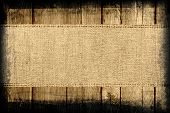 stock photo of wood craft  - Burlap jute canvas banner textured with dark wood background - JPG