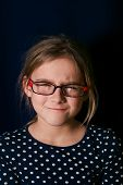 stock photo of character traits  - Portrait of a young girl with suspicious gaze getting angry studio vertical shot - JPG