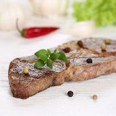 picture of pork cutlet  - Roasted pork chop steak cutlet meat on a wooden table - JPG