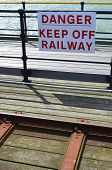 picture of railroad-sign  - Danger keep off railway sign beside the English coast - JPG