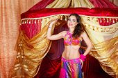 picture of belly-dance  - Sexy oriental beauty dancing belly dance in front of the tent - JPG