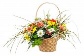 image of centerpiece  - Flower bouquet from multi colored chrysanthemum and other flowers arrangement centerpiece in wicker basket isolated on white background - JPG
