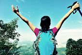 picture of open arms  - young cheering woman hiker open arms at mountain peak - JPG