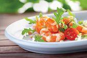 stock photo of tiger prawn  - Salad of king prawns and rukola in a white plate - JPG