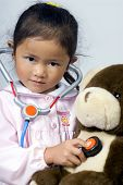 image of health-care  - a young girl cares for her sick bear - JPG