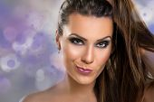image of crazy face  - Portrait of a cute young brunette woman making a face with perfect make - JPG