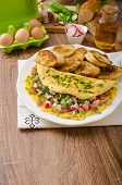 stock photo of french toast  - Omelette with spring vegetables and bacon fresh peas and radish garlic french toast sprinkled with chive and microgreens - JPG