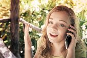 picture of little girls photo-models  - Outdoor portrait of beautiful blond Caucasian teenage girl in a park talking on a cell phone vintage toned photo filter effect - JPG