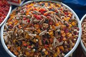 stock photo of mixed nut  - A mix of dried fruits and nuts at market place - JPG