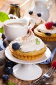 foto of curd  - Delicious homemade tartlets served with lemon - JPG