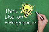 foto of entrepreneur  - Entrepreneur concept with light bulb on chalkboard - JPG