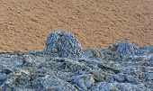 picture of scoria  - Black Spatter Cone against a Red Cinder Cone on Santiago Island in the Galapagos - JPG