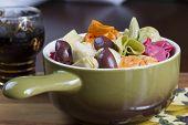 picture of kalamata olives  - Colorful Italian pasta dish served with artichoke hearts and kalamata olives in a ceramic bowl accompanied by a glass of Chianti wine for dinner or lunch - JPG