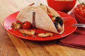 stock photo of tacos  - big mexican taco with tomatoes and mushroom - JPG