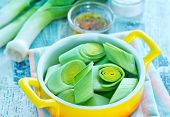stock photo of leek  - raw leek in bowl and on a table - JPG