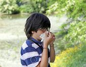 pic of allergy  - young boy with pollen allergy with handkerchief in hand - JPG