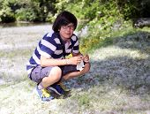 picture of allergy  - young boy with pollen allergy with handkerchief - JPG
